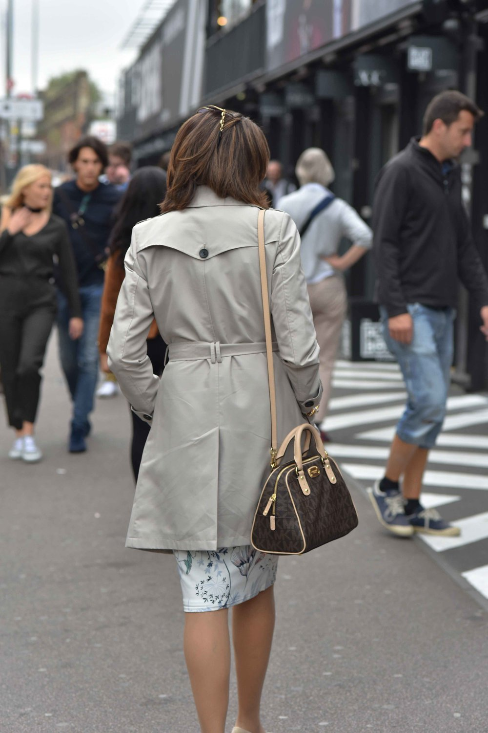 Michael Kors crossbody brown leather bag, clicked at Shoreditch, London, U.K. Image©sourcingstyle.com