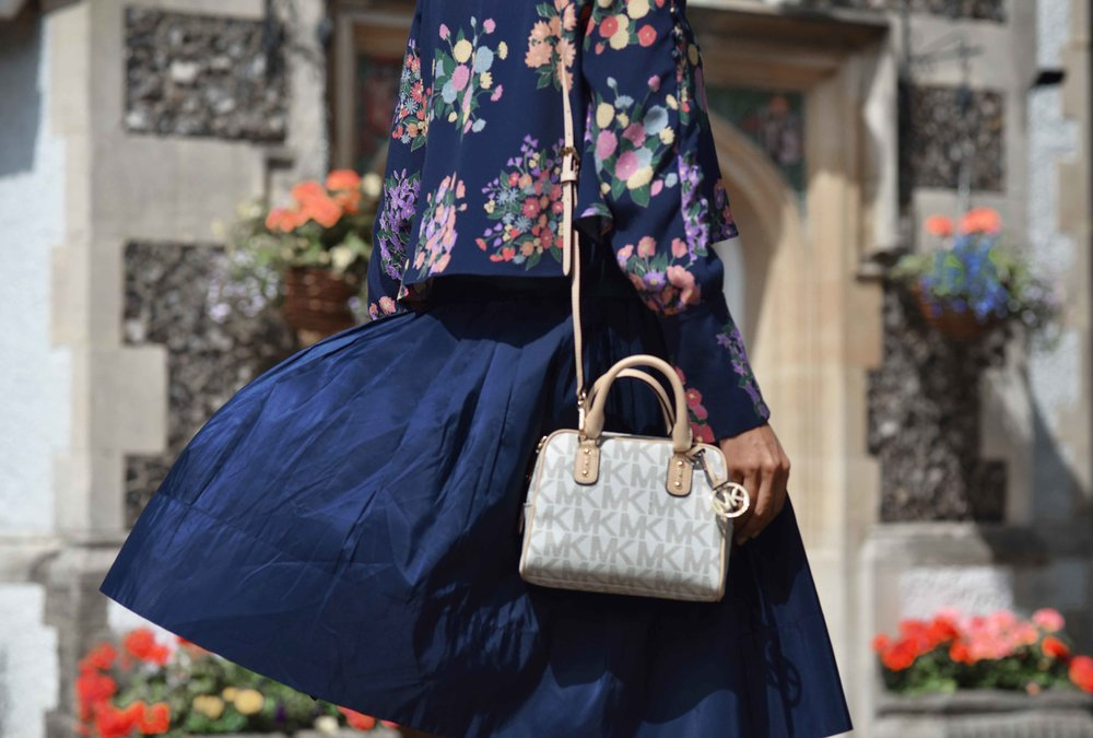 Zara floral top, Talbots silk Taffeta skirt, Michael Kors bag. Image©sourcingstyle.com