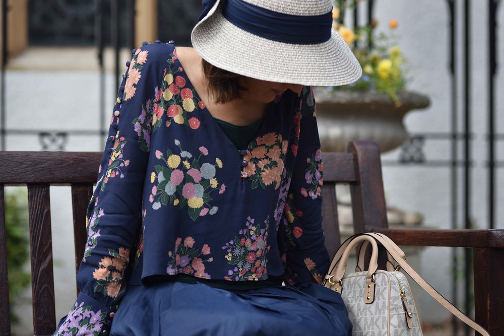Zara floral top, Talbots silk Taffeta skirt, Talbots silk camisole, Michael Kors bag, M&S hat. Image©sourcingstyle.com
