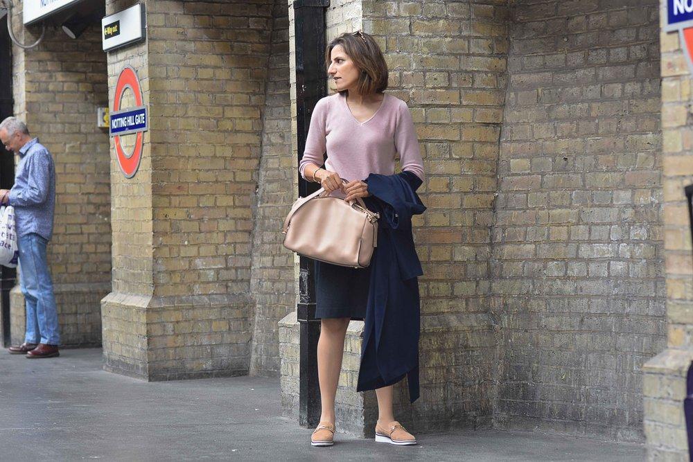 Marks & Spencer trench coat, Marks & Spencer knit top, Karen Millen bag, River Island shoes, Notting Hill underground station, London. Image©sourcingstyle.com