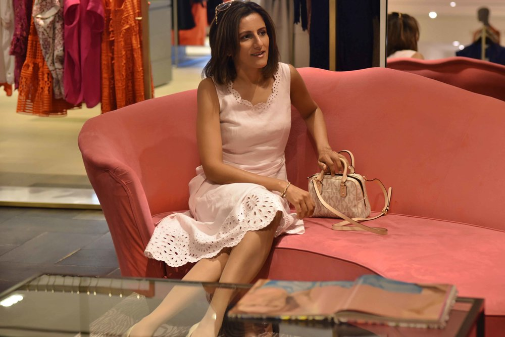 wearing a pink Talbots linen dress, Michael Kors bag, Selfridges, London, U.K. Image©sourcingstyle.com