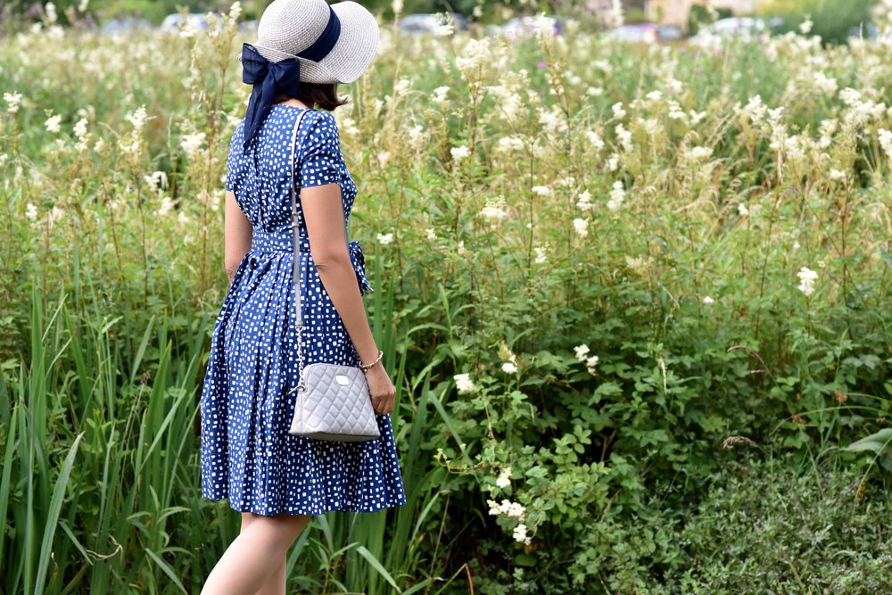 In a Prada dress, Michael Kors bag, Arlington Fields, Bibury, Cotswold, England. Image©sourcingstyle.com