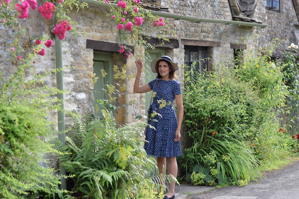 Prada dress, Prada ballet flats, Cotswold stone cottages, Arlington Row, Bibury, Cotswold, England. Image©sourcingstyle.com