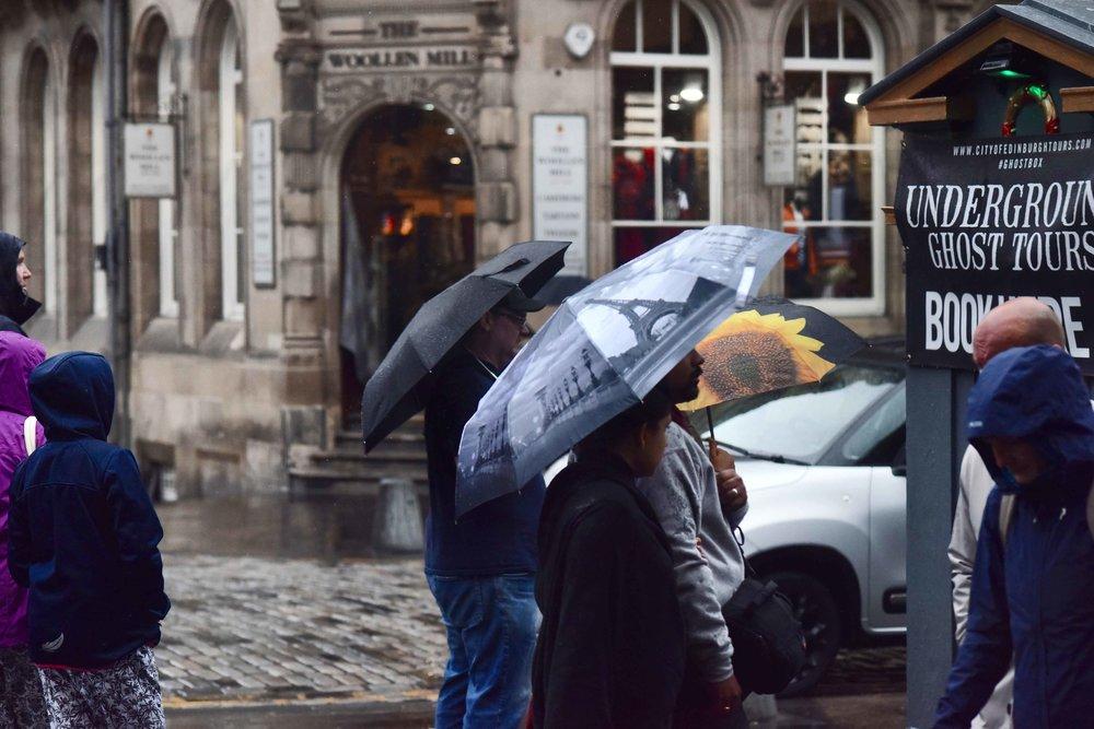 Rainy weather, umbrellas in fashion, Edinburgh, Scotland. Image©sourcingstyle.com