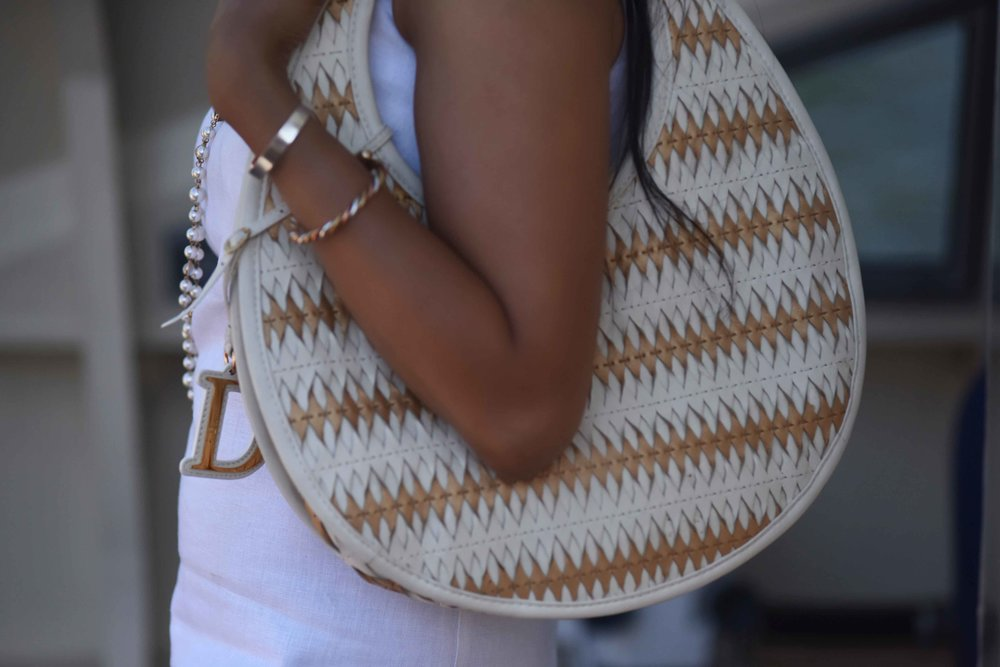 Dior bag, ASOS dress, pearl necklace. Image@sourcingstyle.com
