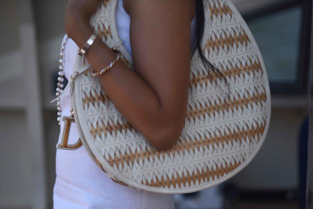 Dior bag, ASOS dress, pearl necklace. Image@sourcingstyle.com