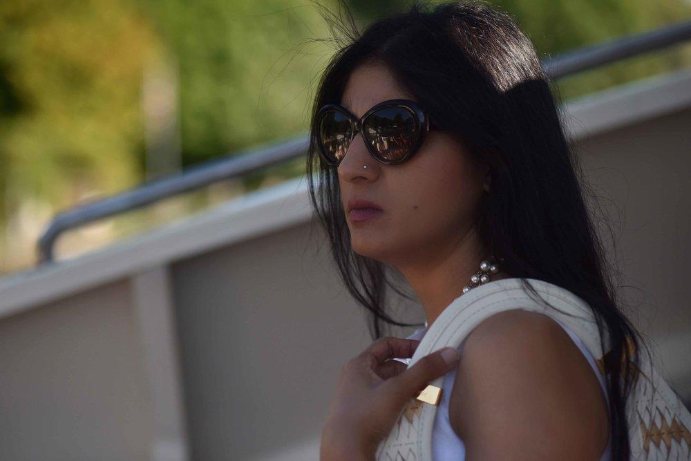 Jimmy Choo sunglasses, Dior bag, ASOS dress, pearl necklace, Ruchi Goenka, makeup artist, UK. Image@sourcingstyle.com