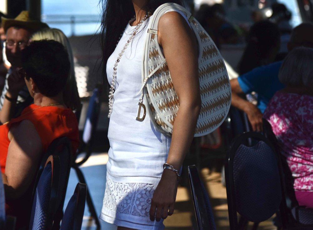 Dior bag, ASOS dress, pearl necklace, Ruchi Goenka, makeup artist, UK. Image@sourcingstyle.com