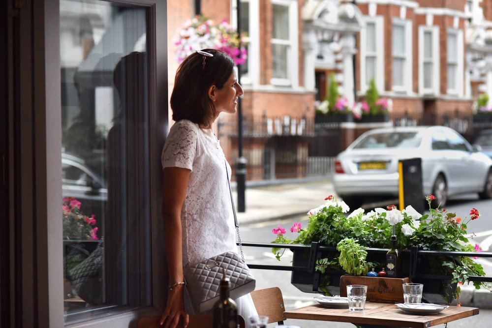 Marks & Spencer white lace top, Michael Kors grey quilted crossbody bag, Real Greek restaurant, London. Image©sourcingstyle.com