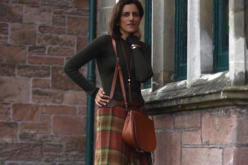 Ralph Lauren Blue Label plaid uneven hem skirt, tan Clarks bag, Inverness. Image©sourcingstyle.com