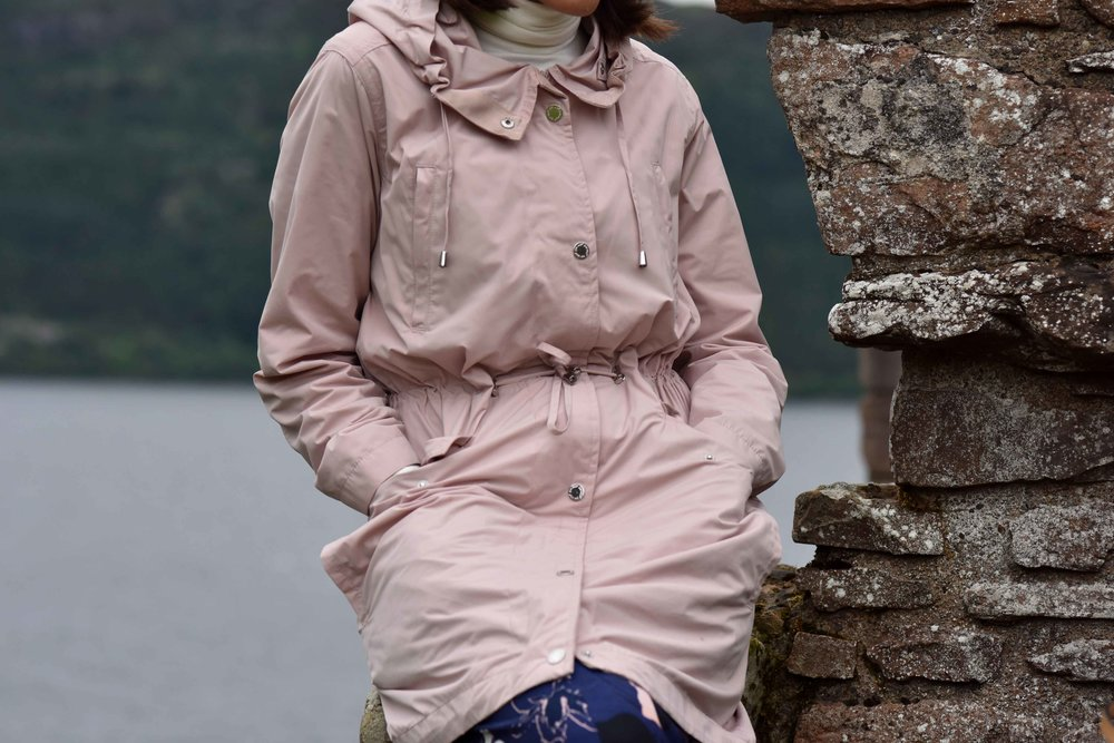 Pink Stormwear jacket, water repellent jacket, Urquhart Castle, Loch Ness, Scotland. Image©sourcingstyle.com