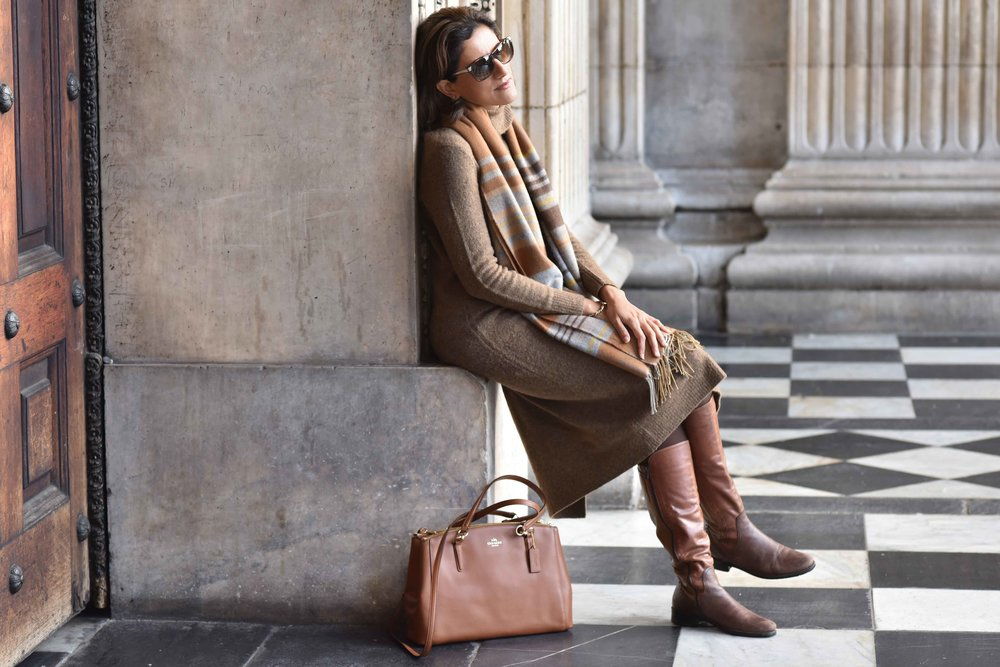 Marks & Spencer sweater dress, Marks & Spencer plaid scarf, Coach handbag, Italian boots, Gucci sunglasses. Photo: Alizeh Latif. Image©sourcingstyle.com.