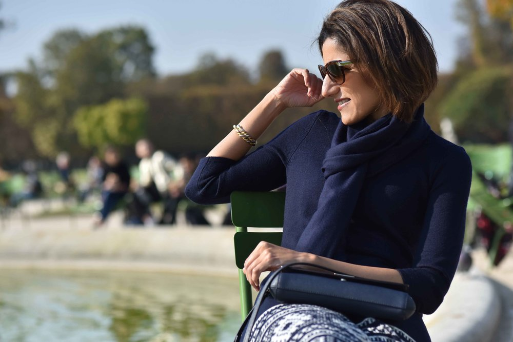 Ralph Lauren woolen jersey knit dress, Marks & Spencer knee high boots, Kate Spade sling bag, Jardin de Tuileries, Paris. Photo: Nina Shaw. Image©sourcingstyle.com