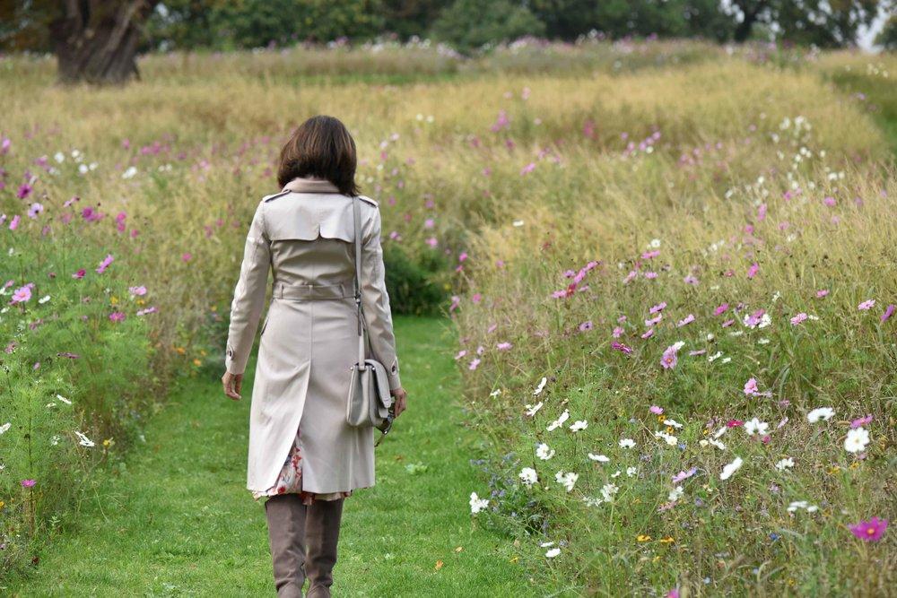 Karen Millen trench jacket, Karen Millen boots, flower fields, Coworth Park hotel, Ascot. Image©sourcingstyle.com
