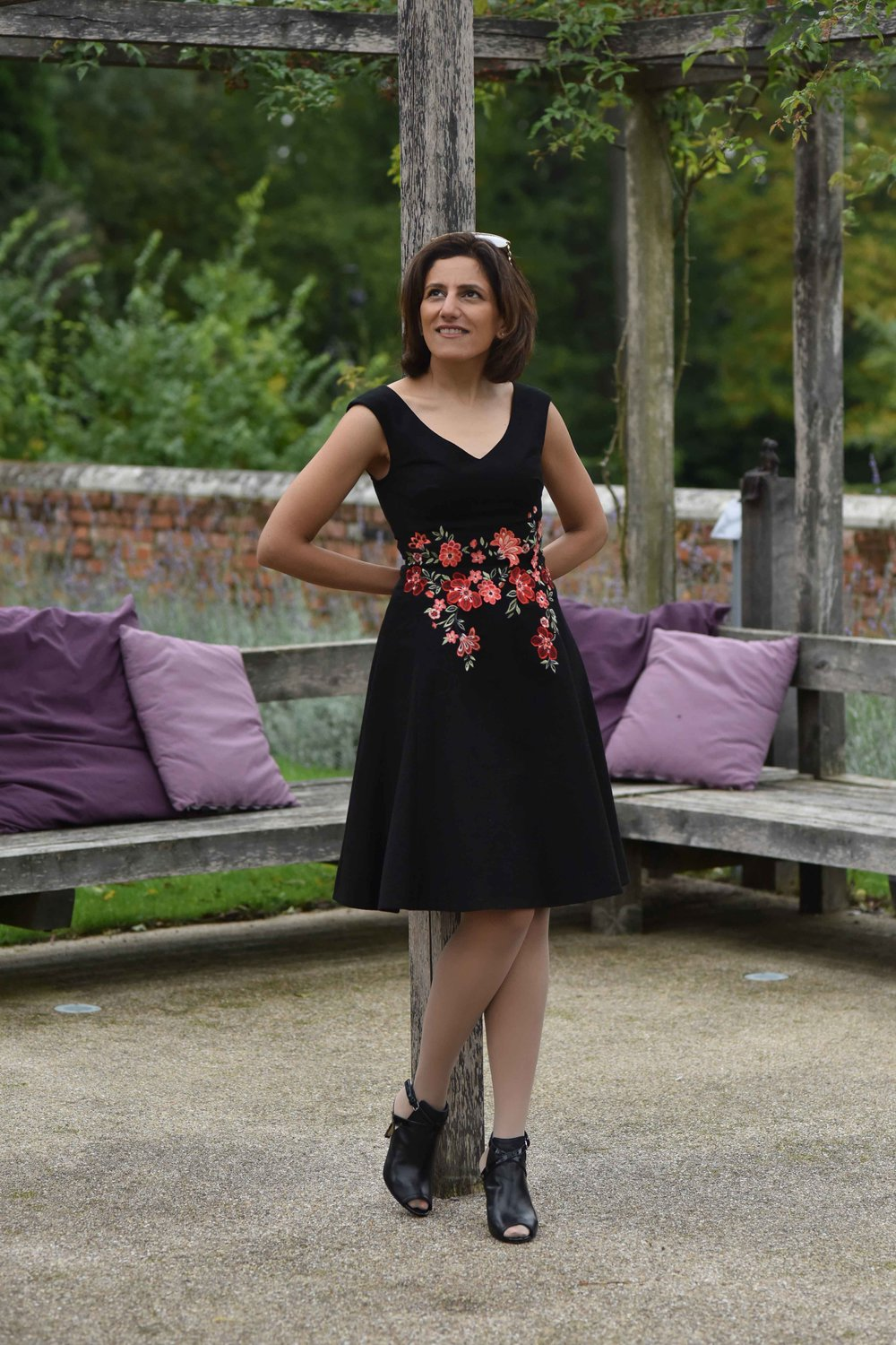 Karen Millen black embroidered dress, sandals, Coworth Park hotel, Dorchester Collection, UK. Image©sourcingstyle.com