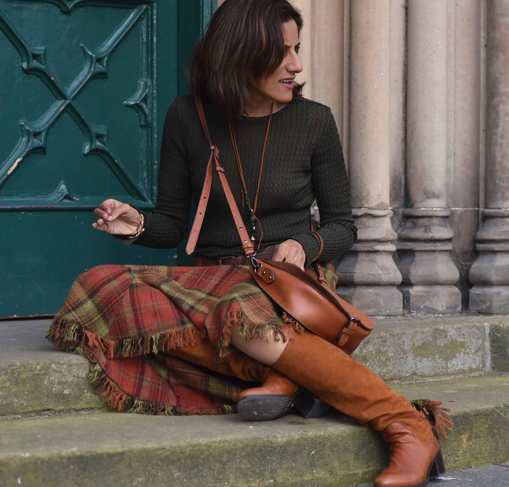 Ralph Lauren Blue Label plaid uneven hem skirt, tan Clarks bag, tan boots, Inverness. Image©sourcingstyle.com