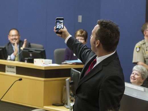 Superintendent Watson delights crowd as he takes a selfie after being sworn in as Maricopa County School Superintendent.