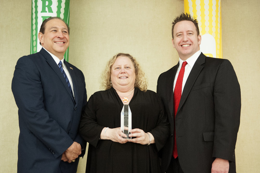 Sunset Elementary School Principal, Kristi Langley-Wells (center) receives Exemplary Principal award from Superintendent Watson and Cartwright Elementary District Superintendent, Jacob Chavez (left).