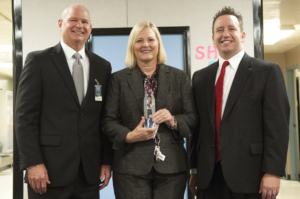 Superintendent Watson presents Jan Stevens (center) with Exemplary Principal award with Paradise Valley Unified District Superintendent, James Lee.