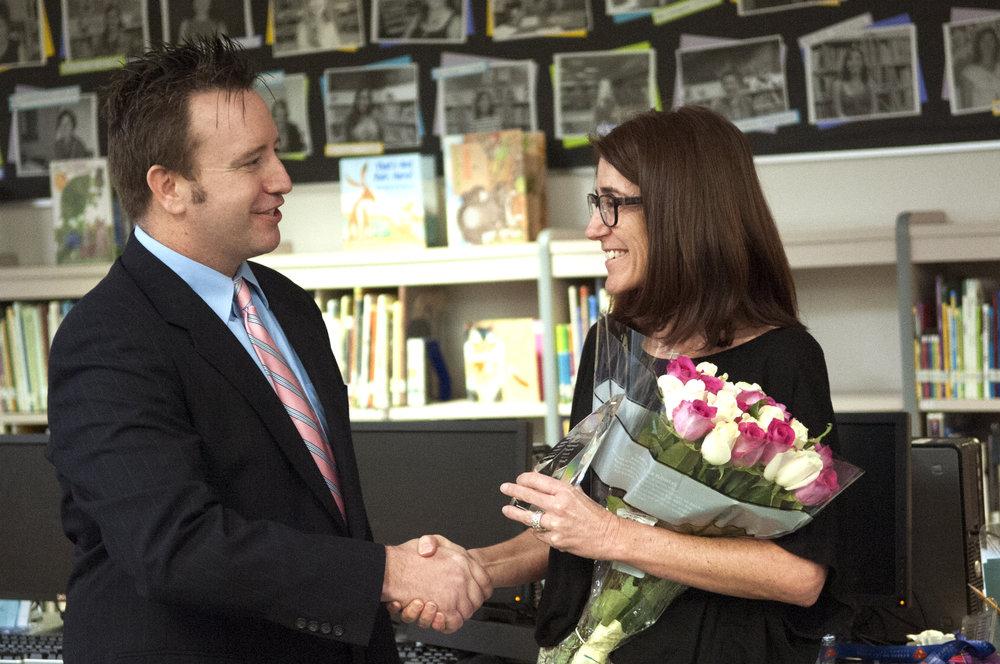 Superintendent Watson presents Tonja Yaung, principal of Kyrene de los Ninos, with the Exemplary Principal award.