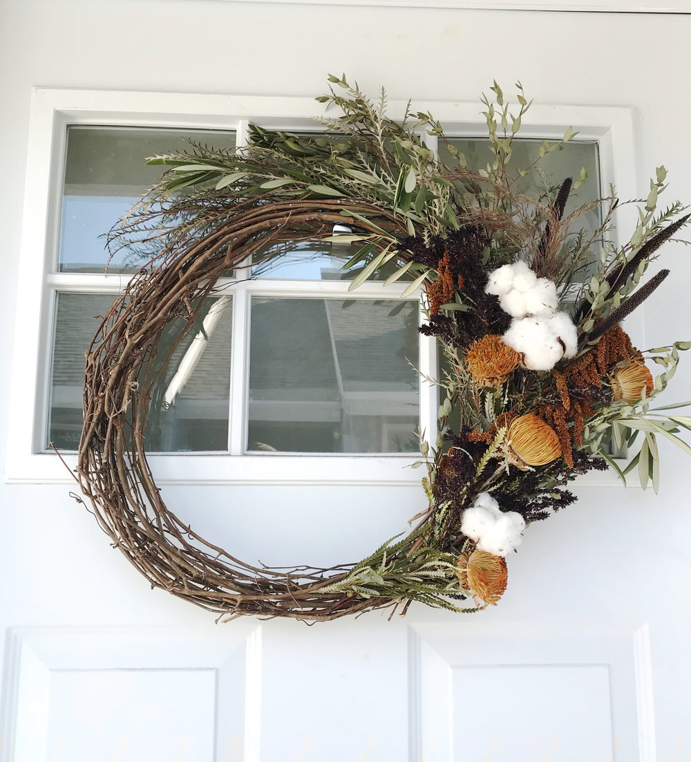 Fall-colored, textural foliage comprised the asymmetrical wreath I made for the front door to set the scene as guests arrived.