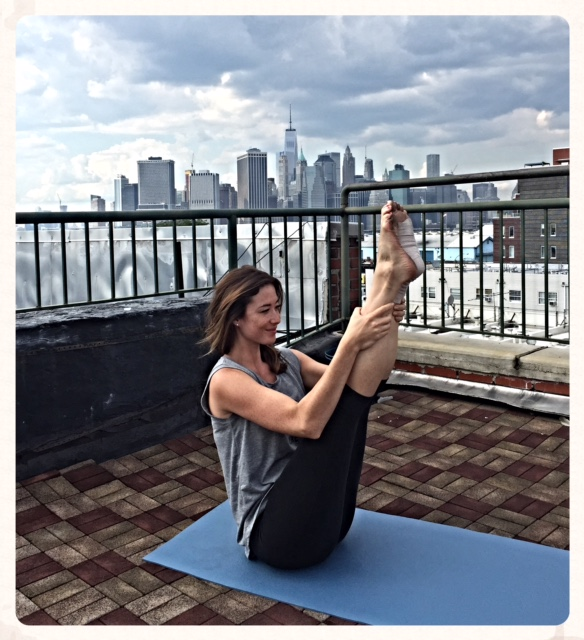I love grabbing my ankles and pulling up my legs for a good, deep stretch. Release your hands and hold to help build core muscles. I like to hold this pose for a least 20 seconds. Depending on your injury, you may need to keep your feet flat as opposed to pointed.