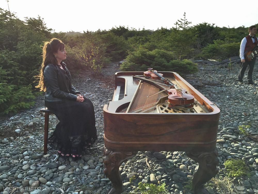 Camille with piano on the beach
