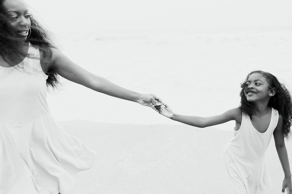 mom-daughter-holding-hands-melbourne-beach-florida.jpg