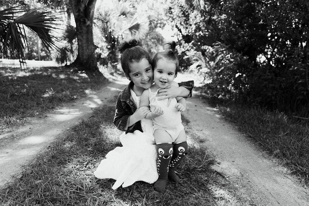 sister-hugging-long-dirt-road-melbourne-florida.jpg