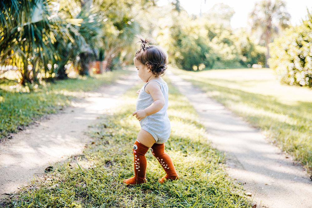 baby-girl-walking-dirt-driveway-melbourne-florida.jpg
