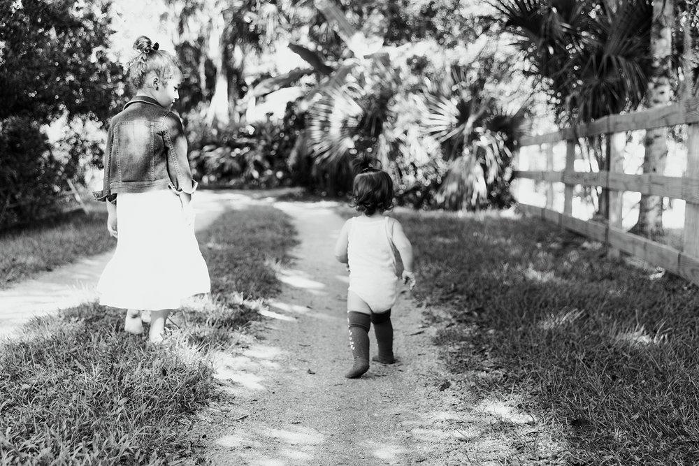 sisters-walking-down-dirt-driveway.jpg