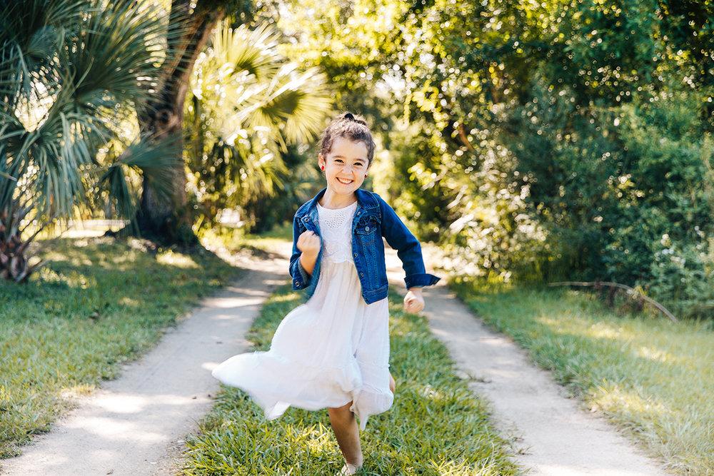 girl-running-down-long-dirt-driveway.jpg