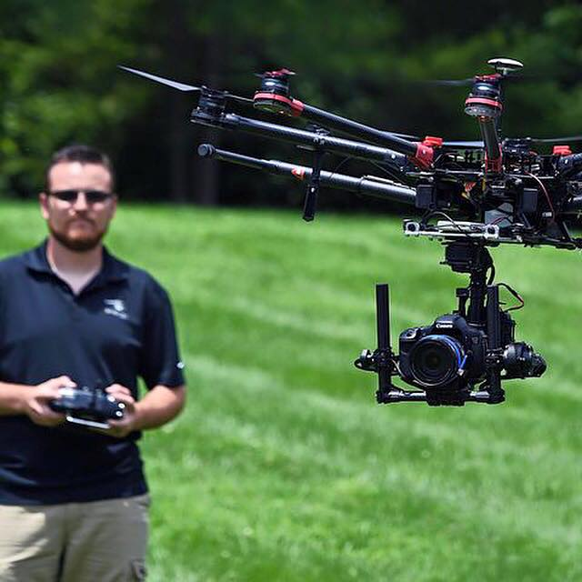 SnapRoll Media co-founder and pilot Spencer Valdez demonstrates flying an unmanned aerial vehicle outside the company's headquarters in Franklin, Tenn. on July 11, 2015. The aerial videography production company has been approved by the FAA to fly for commercial movie & TV production.