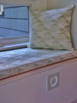 "Detail shot (courtesy of the homeowner) of a Spiral Tide cushion and pillow by Oliveira Textiles. Note the ""Cucumber"" accent on the knob, too."