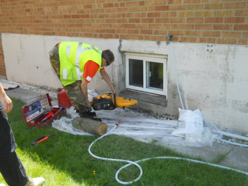 This contractor had to increase the size of this window to comply with the egress requirements of a basement suite