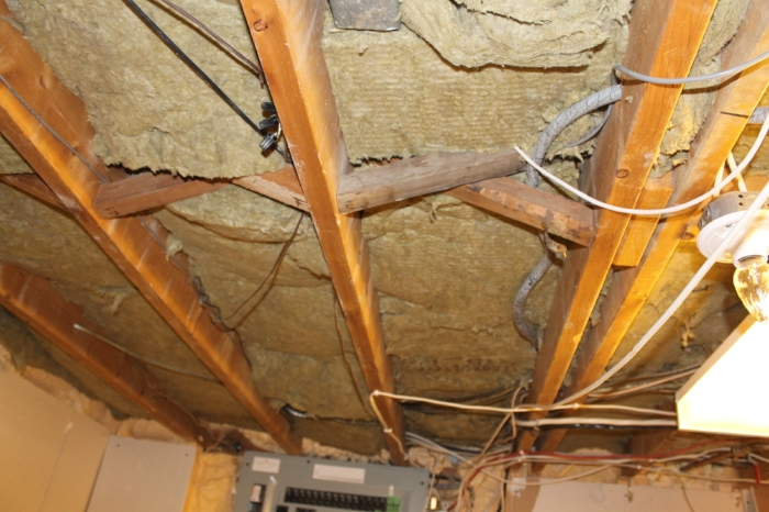 "Absorptive (""Safe N Sound"") insulation installed between the joists before metal channels and drywall goes up"
