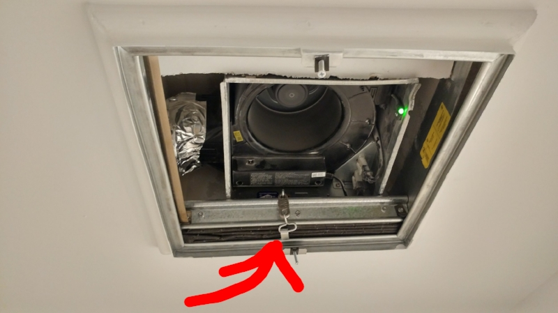 This may look like a boring old bathroom fan, but this one has a cool little ring that snaps open if there's a fire, releasing a fire rated damper that closes the opening shut - not allowing fire to pass through