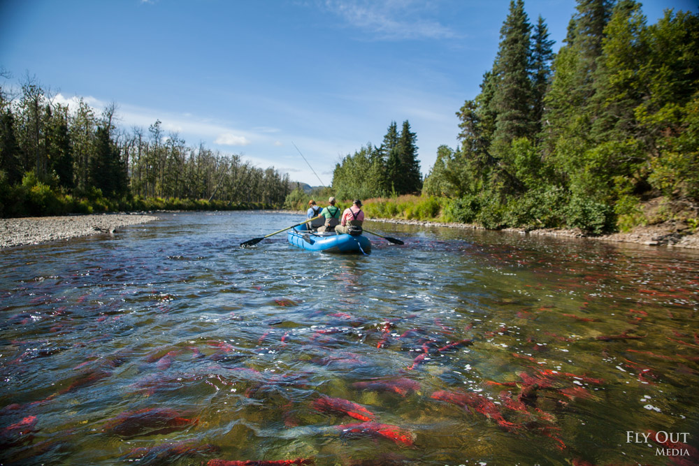 Left: anglers rowing a remote Bristol Bay river atop spawning sockeye salmon. (Photo: Fly Out Media).