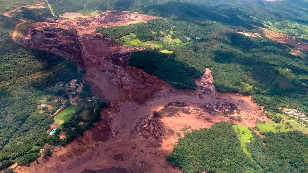 Handout picture released by the Minas Gerais Fire Department showing an aerial view taken after the collapse of a dam, which belonged to Brazil's giant mining company Vale, near the town of Brumadinho in southeastern Brazil, on January 25, 2019. (Photo by HO / Minas Gerais Fire Department / AFP) /