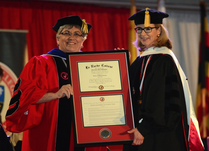Christine Spadafor receiving the Honorary Doctorate from Sister Candace Introcaso, President of La Roche College.