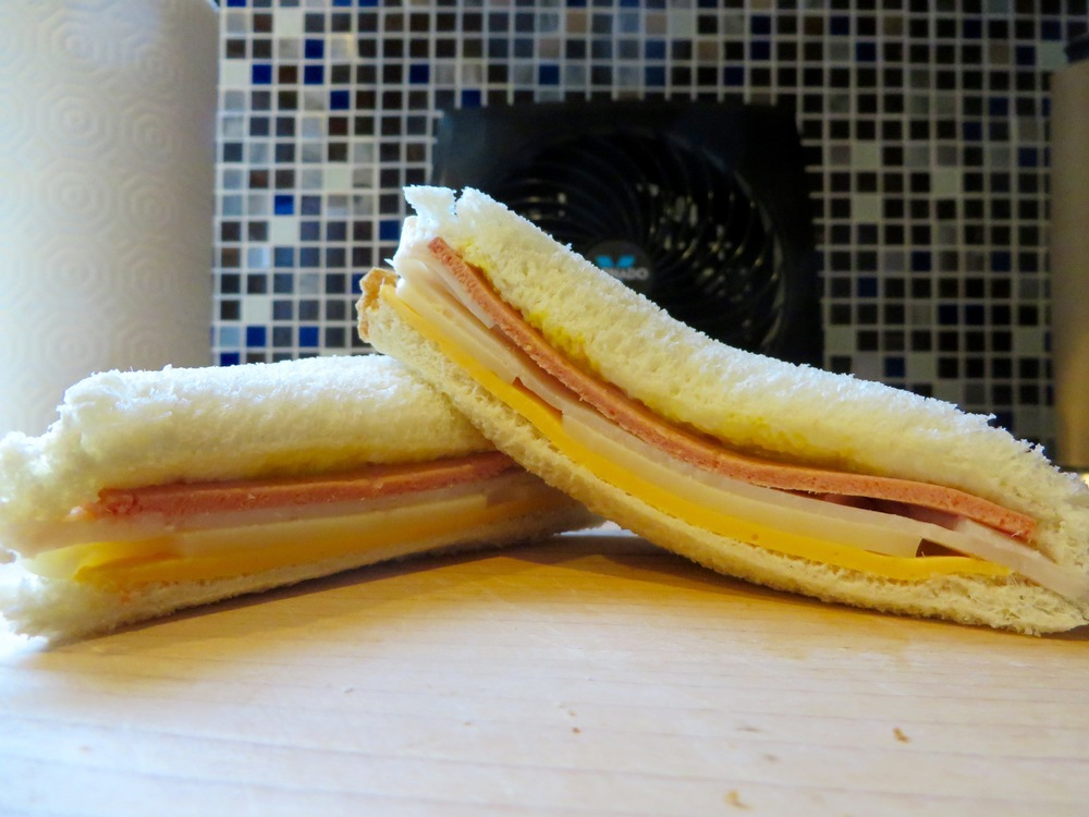 White bread, American cheese, Swiss cheese, Turkey, Bologna, Mustard, Mayo, White bread.