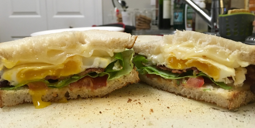 Bread, Mayo, Tomato, Lettuce, Bacon, Egg, Cheese, Bread.