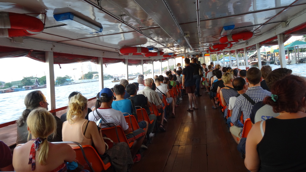 This boat (I believe it was the orange line)is a great way to see the west bank of the city. For less than 20 bhat (.50 cents) you can take a 1.5 hour sunset cruise along the city's Chap Phraya River, the city's western most river. It's typically used as local transportation, but some savvy tourists use it as a cruise.It runs along major tourist destinations like Khao San Road and under the Kanchanaphisek Bridge (yellow cable bridge). I hopped on at Saphan Taksin (BTS) and took it all the way to Bangkwang Central Prison (the last stop on the line).