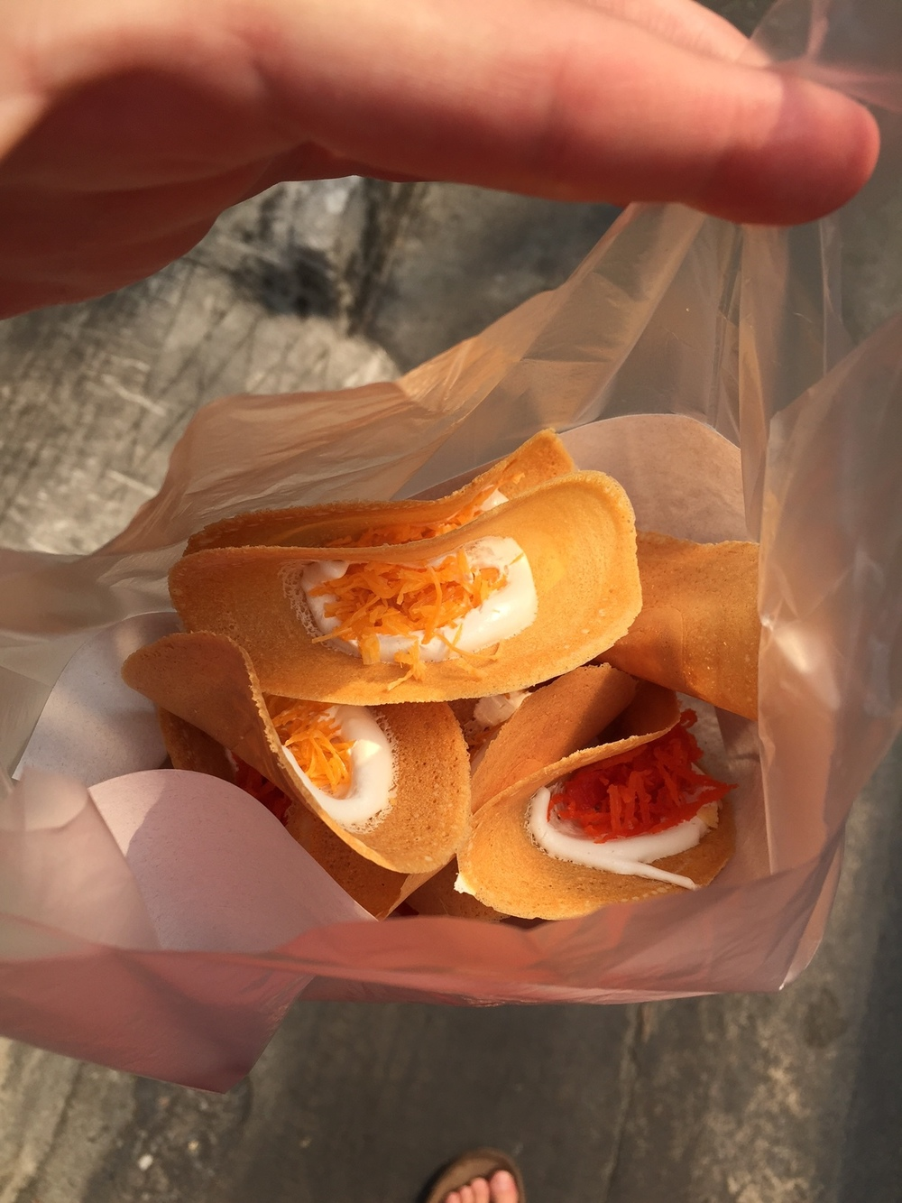 Thai Taco - Fortune Cookie with Melted Marshmellow and Sprinkled with Sugar Fried Coconut