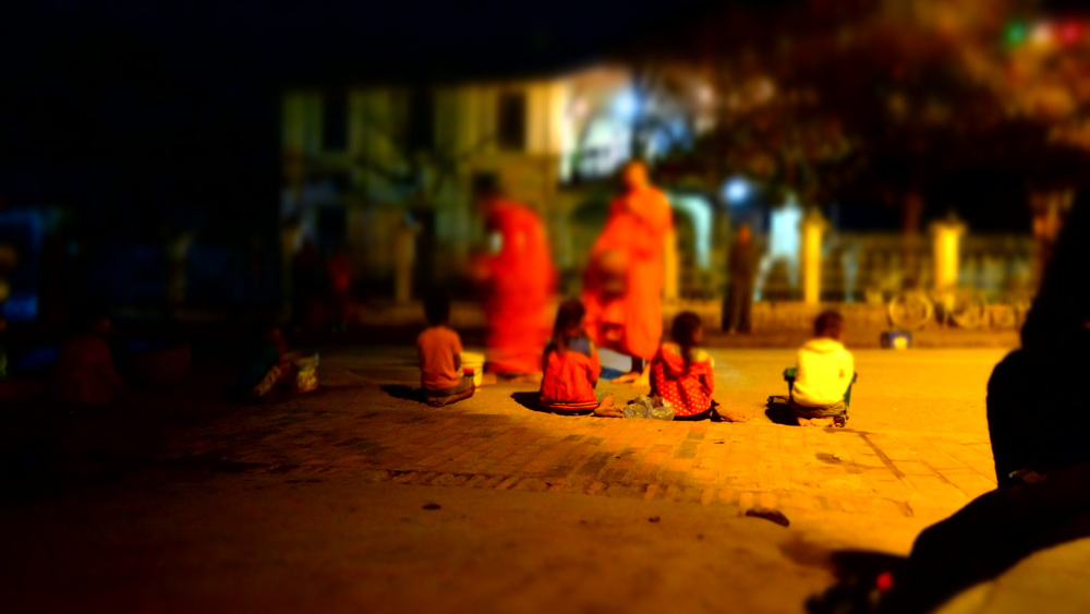 Early morning Alms giving ceremony. Typically the locals will give gifts to the Buddhist monks,but children also line the streets in hopes that the monks will give sweets to them. This was a powerful scene and one that I'll never forget. Just remember, if your a tourist, be sure to obey the local customs.