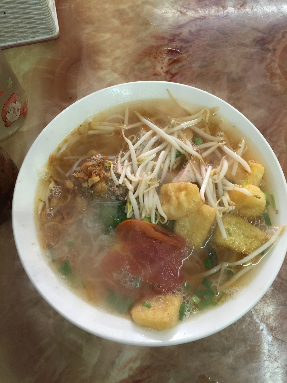 Hué is known for having some of the best food in Vietnam. No, this is not pho, it's bun rieu (noodles with tomato broth and crab).