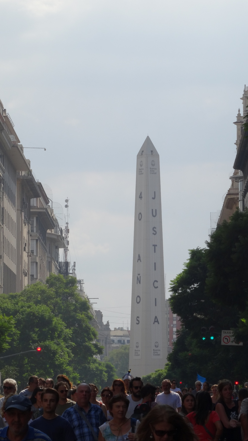 "Located on the famous Av. 9 De Julio, Obelisco de Buenos Aires. It's often been used as a political prop or to gain awareness for certain issues. In 2005 it wore a giant pink condom for World Aids Day. However, on the day I took the picture you can see the sign ""40 years of Justice"". What you can't see is the other two sides of the obelisk, ""Memory and Truth"" So, all together it reads, ""40 years... (asking for) Memory, Truth, and Justice"""