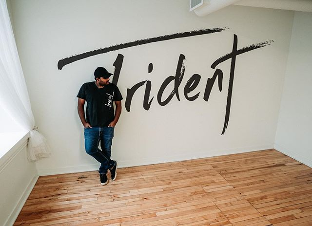 """November 1st, 2018. This is what I wake up to this morning. • 9 years of Trident. The name, the brand, the company. And today, a brand new office. • It's crazy even thinking about the fact that, everything I have learnt and everybody I have known in these past 9 years, in someway shape or form is because of these 7 letters. • They say life is the sum of all the mini and major decisions that we make along the way. Sometimes, decisions that we think are insignificant are the ones responsible for changing the course unbeknown to ourself. • I often go back to the moment when I asked my dad to listen to a really bad track that I """"produced"""" on my laptop 10 years ago.  He listened to the entire 2:30 minutes of it and all he said was, """"It's Okay! It could be better!"""" What he actually meant was, """"This sounds like Sh*t!"""" But, he didn't stop there. He said, """"If you are into making music, look at what other paths it could lead you into and maybe try your hands on one or… all of them. Maybe there is something you haven't tried that you might like!"""" And I said.. """"Hmm.. Maybe I will give DJing a shot!"""" • That was the moment that changed the ENTIRE course for me. The journey since that moment has been full of ups and downs, late nights and early mornings, tough decisions, and A LOT of sacrifices. But looking back, I wouldn't change a single. thing. It's what I love to do. This.. is what #TeamTrident loves to do. • And now, we are at a major milestone.  As of today, Trident's new office will be located on the second floor of the brand new Bass Building, Downtown on 10th & Rosser. • For some, this might be insignificant. For us here at Trident - it's HUGE. This building is filled with some amazing people that I feel absolutely privileged to be a part of and I can't wait to see the awesomeness that we all get to create. • I'm filled with gratitude. Thank you to everybody that has been a part of this journey! It means a lot more than I can put into words. This is surreal. • All said an"""