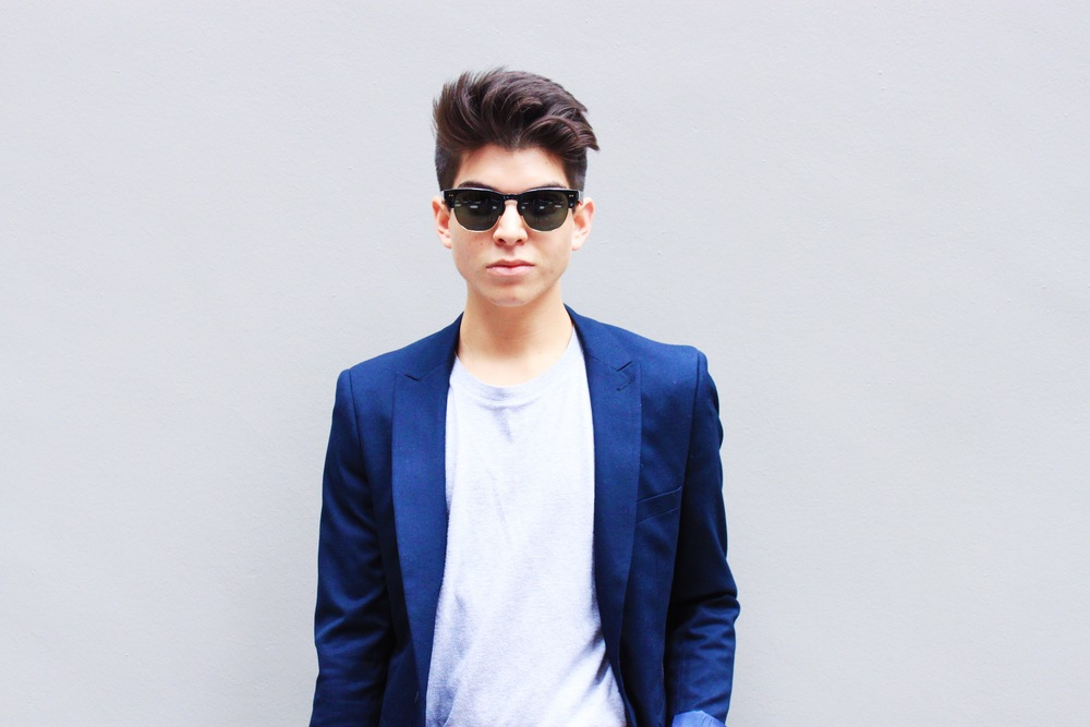 Style blogger Anthony Villegas in a navy Topman Skinny Fit Suit.