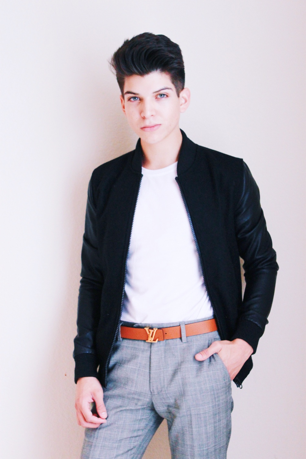 Anthony Villegas in black Topman bomber jacket with leather sleeves.